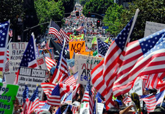 Thousands of demonstrators march during a May Day immigration rally on May 1, 2010 in Los Angeles, California. More than 100,000 people were expected to march from four directions towards Los Angeles City Hall to protest Arizona's new immigration law.