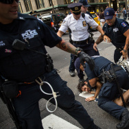A protestor, who was marching on 5th Avenue against white supremacy and racism, is arrested by New York City Police (NYPD) officers, August 13, 2017 in New York City.