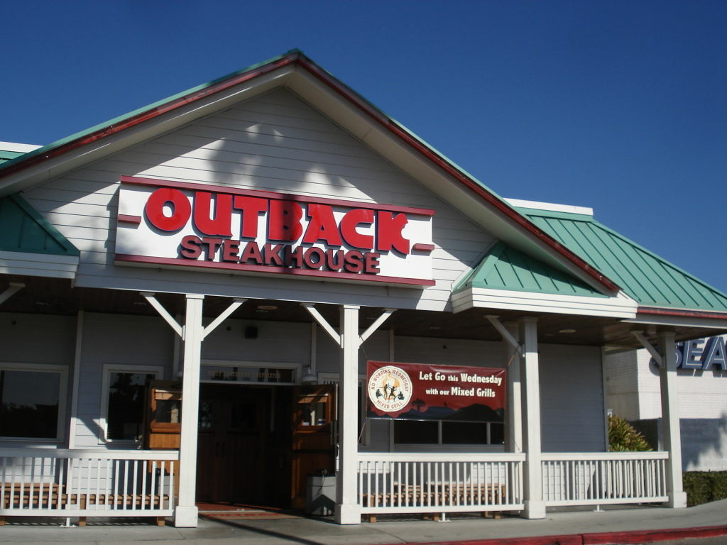 A typical Outback Steakhouse seen here next to a Sears store.