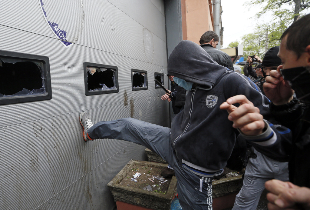 Participants at a rally attack a police station in Odessa as they demand the release of people arrested after recent street battles between pro-Russian and pro-Ukrainian supporters in the Black Sea port city.