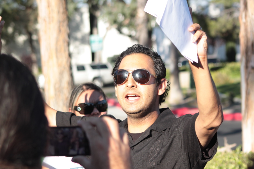 Temecula immigration rights activist Ray Navarro stands outside Temecula City Hall at a rally two weeks ago.