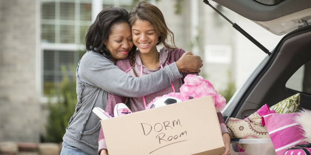 Parent and child preparing to move into a college dorm