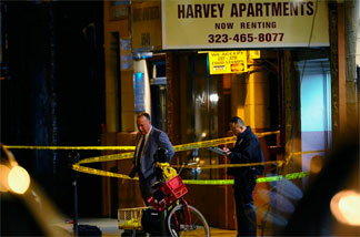 The scene Wednesday, December 1, 2010 outside the Los Angeles apartment house where a man authorities wanted to question about the murder of publicist Ronni Chasen killed himself as police approached.