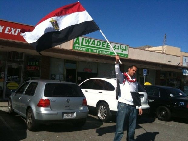 "Mohamad Said celebrates outside a bakery on Brookhurst Avenue in Anaheim, a stretch dubbed the ""Gaza Strip"" for its many businesses catering to Middle Eastern immigrants. February 11, 2011"