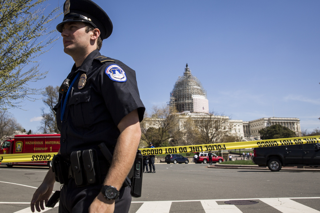 U.S. Capitol Police officers stand outside the west front of the U.S. Capitol on Capitol Hill, April 11, 2015 in Washington, DC.