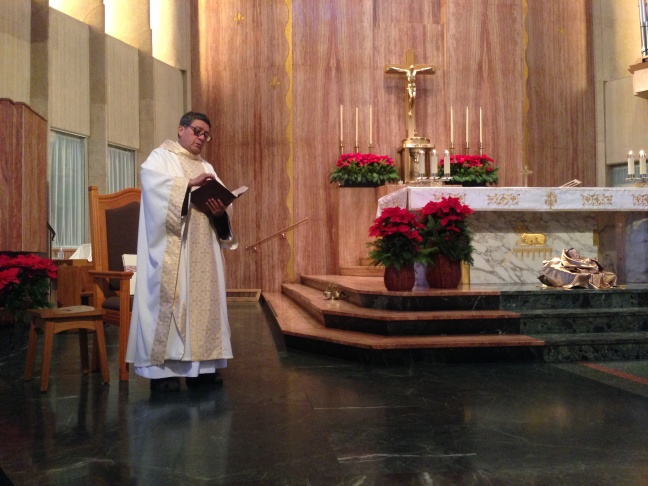 Associate Pastor David Guzman leads a Christmas morning mass at St. Therese Roman Catholic Church in Alhambra. About 150 people attended the 9 a.m. sermon.