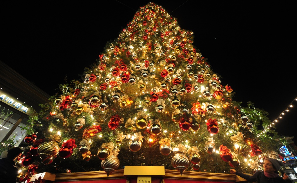 People get a closer view of a Christmas Tree decorated and displayed for the festive season at the Grove in Los Angeles, California, in December 2011.