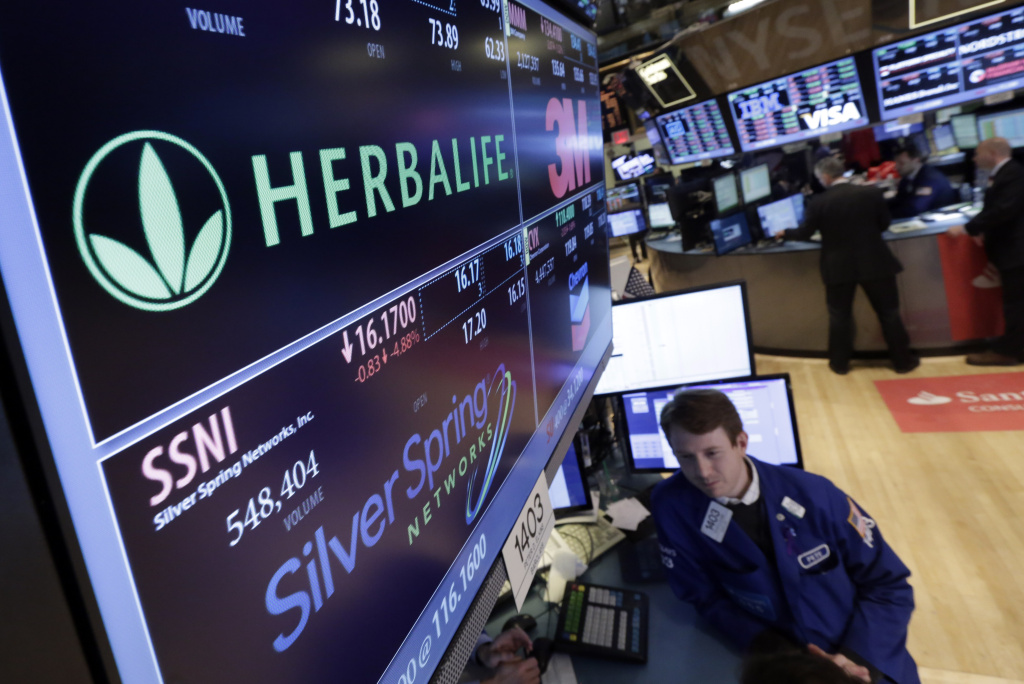 Specialist Peter Elkins foreground, works at the post thta handles Herbalife, on the floor of the New York Stock Exchange, Thursday, Jan. 23, 2014. Herbalife Ltd. shares fell Thursday after U.S. Sen. Edward Markey called for an investigation into the company's business practices.