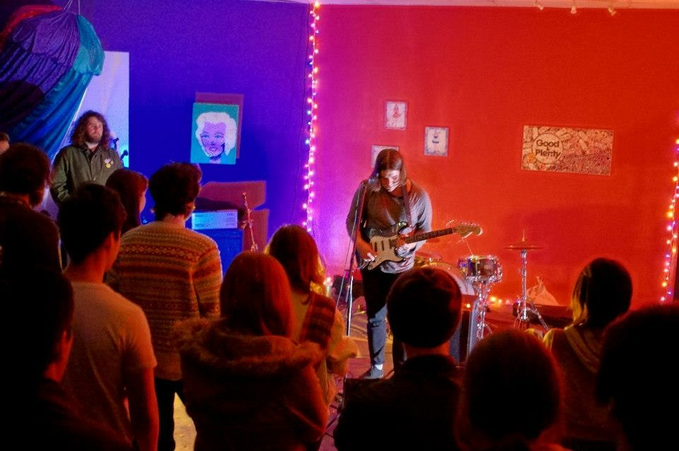 Michael Vidal plays guitar at a concert inside Perhspace.