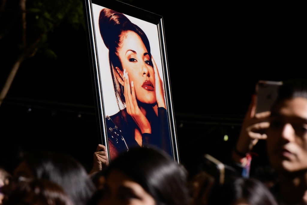 A fan holds a photo of Selena during the ceremony honoring singer Selena Quintanilla with a star on the Hollywood Walk of Fame on November 3, 2017.