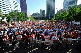 Teachers, students and their parents participate in an education budget cuts rally and protest at Pershing Square on May 13, 2011 in downtown Los Angeles, California.