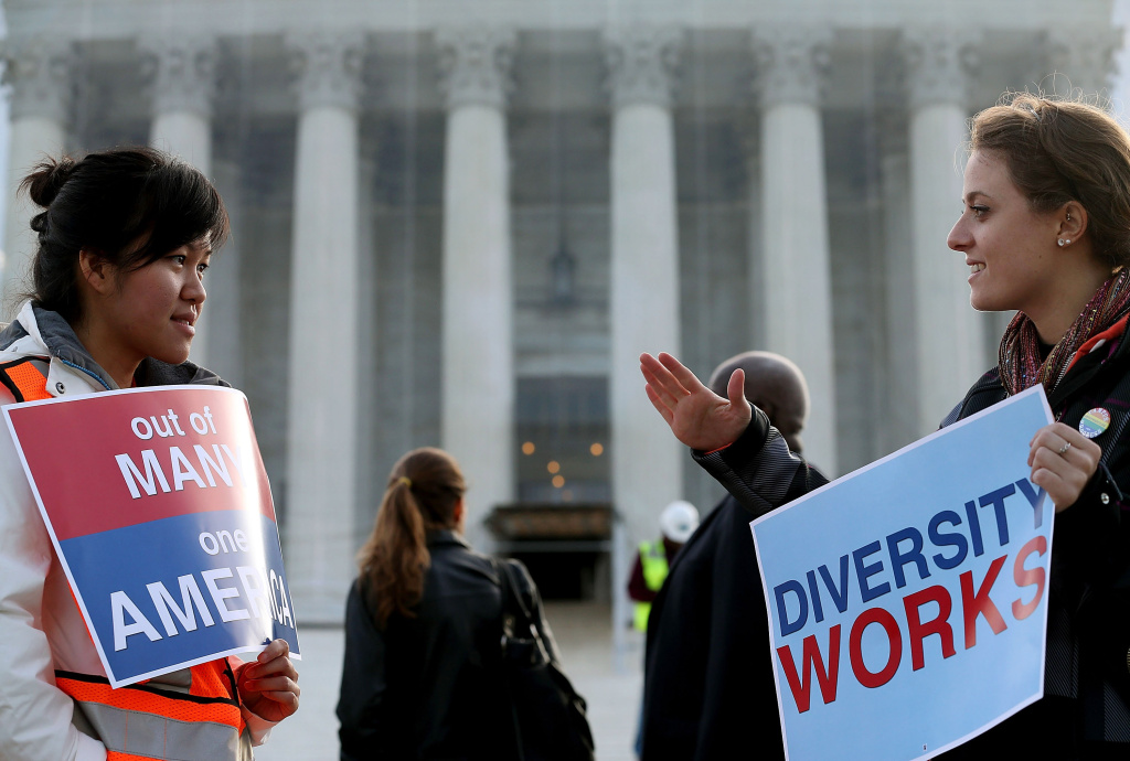 People protest in front of the U.S. Supreme Court on October 10, 2012 as they are scheduled to hear arguments related to affirmative action.
