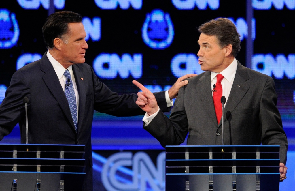 Former Massachusetts Gov. Mitt Romney (L) and Texas Gov. Rick Perry (R) participate in the Republican presidential debate in Las Vegas, Nevada.