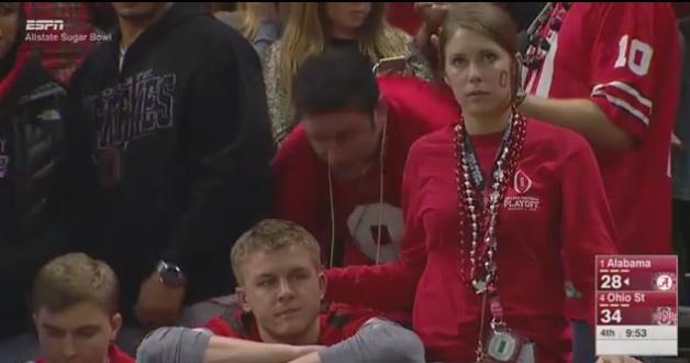 A fan appears to console another fan.