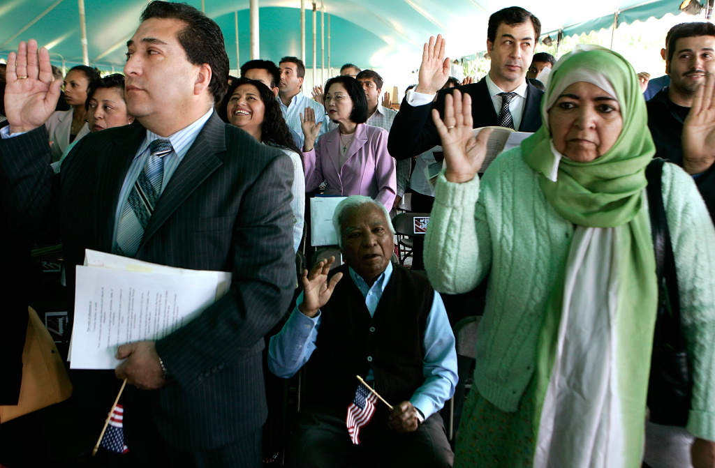 "Immigrants are sworn in as citizens during a ceremony May 21, 2007 at George Washington's Mount Vernon Estate and Gardens in Mount Vernon, Virginia. The Senate today began debate on a compromise immigration reform bill which allows illegal immigrants to obtain a renewable ""Z visa"" after paying a fine, after which they'd be able to get on track toward permanent residency."