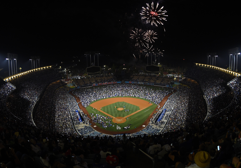 Fans watch a fireworks show after the game between the Los Angeles Dodgers and the Arizona Diamondbacks at Dodger Stadium on July 4, 2017 in Los Angeles, California.