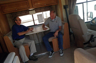 RV salesman Bob Lacey, left, and Altmans Winnebago president Joe Altman, right, talk inside an RV at Altmans Winnebago. Altmans Winnebago is closing after 40 years.