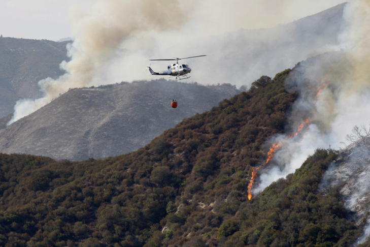 A U.S. Forest Service firefighter works among flames during attempts to contain the Williams fire in the Angeles National Forest on Sept. 3, 2012 north of Glendora.