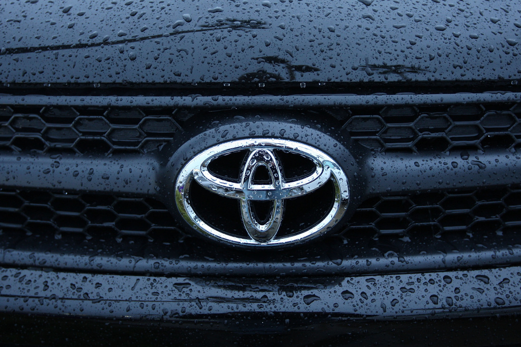 File: Rain water beads up on a Toyota RAV4 at the Tustin Toyota dealership on January 26, 2010 in Tustin, California.