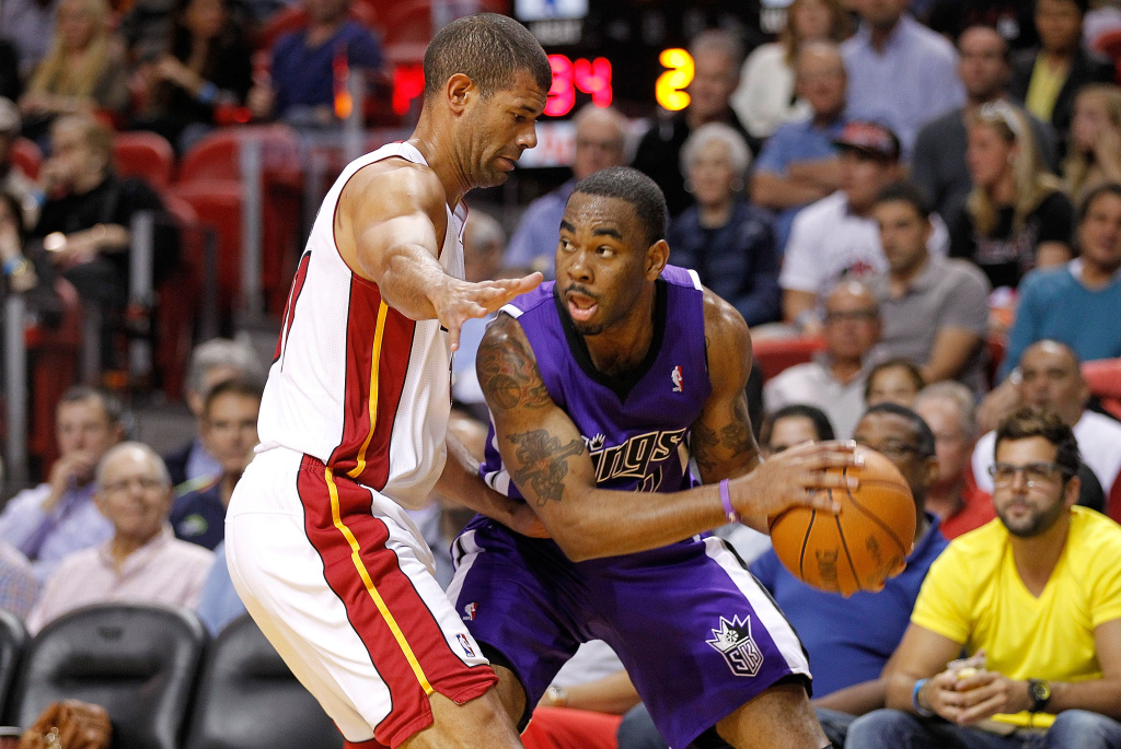 Tyreke Evans of the Sacramento Kings looks to pass around Shane Battier of the Miami Heat.