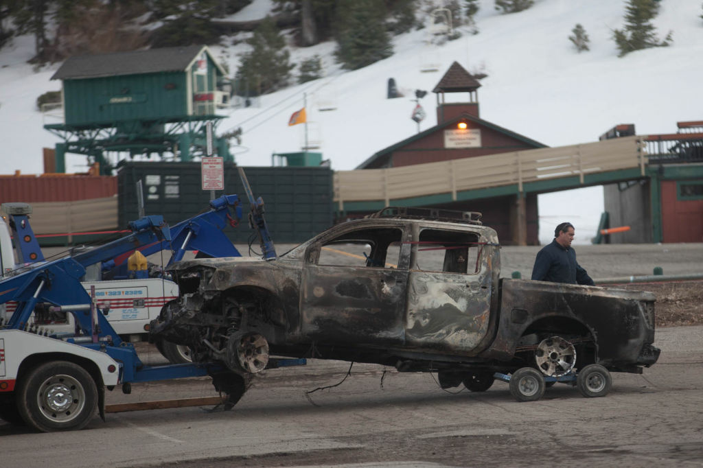 The truck belonging to Christopher Dorner is towed to a police command center at Bear Mountain Ski Resort. Police say Dorner burned the truck and a hunt for the suspect is ongoing.