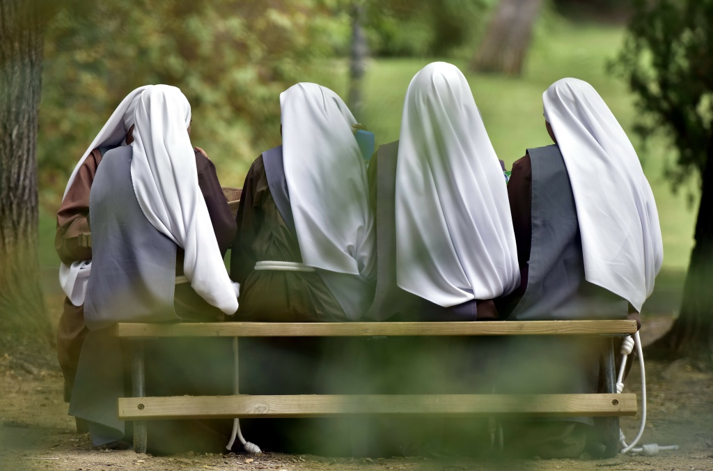 Nuns have lunch at the Atena park of Madrid on September 15, 2016.