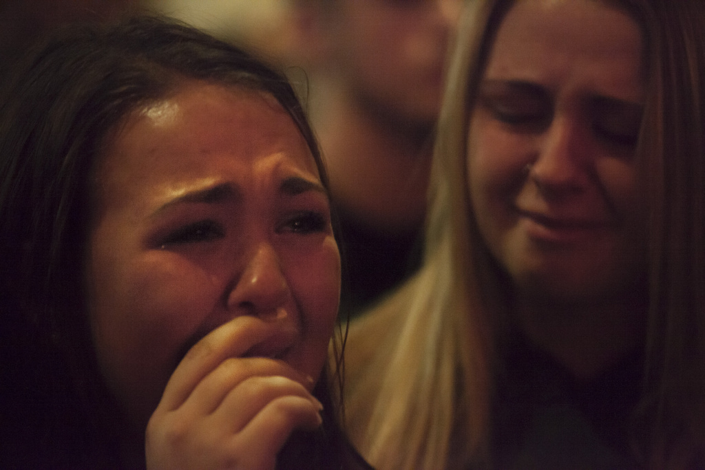 Students from Marysville-Pilchuck High School grieve during a vigil at the Grove Church on Oct. 24, 2014 in Marysville, Washington.