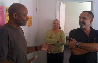 CJ Ford speaks with Special Projects Manager Daryl Webb in his office