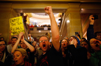 Protesters react to an appearance by Republican Gov. Scott Walker at a news conference inside the Wisconsin State Capitol February 21, 2011 in Madison, Wisconsin.