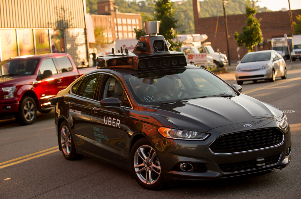 An Uber driverless Ford Fusion drives down Smallman Street in Pittsburgh in this September, 22, 2016 file photo. On Wednesday Uber launched an expansion of its public pilot program for driverless cars in the company's hometown of San Francisco.