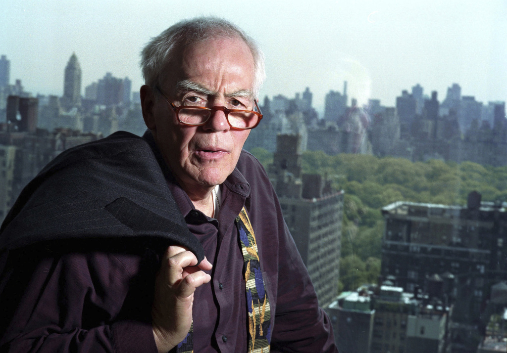 FILE - In this Nov. 2, 2004, file photo, author-columnist Jimmy Breslin poses for a photo in his New York apartment. Breslin, the Pulitzer Prize-winning chronicler of wise guys and underdogs who became the brash embodiment of the old-time, street smart New Yorker, died Sunday, March 19, 2017. His stepdaughter said Breslin died at his Manhattan home of complications from pneumonia.