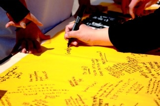 UC Riverside students and staff sign memorial banner for the campus community at their sister city, Tohoku University in Sendai, Japan.