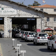 A convoy of inspectors from the Organization for the Prohibition of Chemical Weapons crosses into Syria at the Lebanese border crossing point of Masnaa on Tuesday.