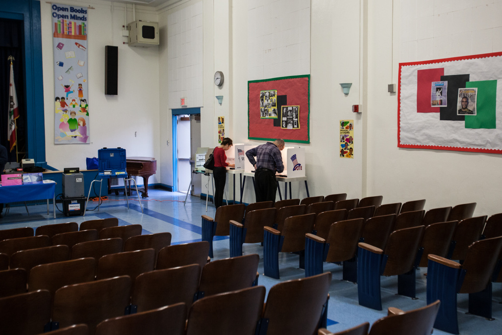 Voters cast their ballots in the auditorium at Palms Elementary School in Culver City on March 5th, 2013.