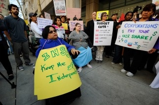 Lillibeth Navarro, executive director and founder of Communities Actively Living Independent & Free, takes part in a rally against proposed budget cuts in front of Gov. Jerry Brown's office on Jan. 10, 2011 in Los Angeles. The rally included several union and community activist groups representing the disabled.