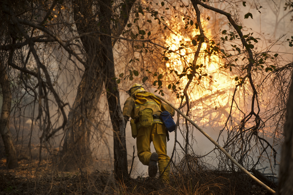 Firefighters work to fight the Colby Fire in the mountains near Glendora on Thursday, Jan. 16, 2014.
