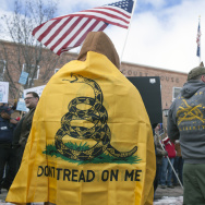 An anti-government protester wrapped in a Gasden flag stands outside the Harney County Courthouse on February 1, 2016 in Burns, Oregon.