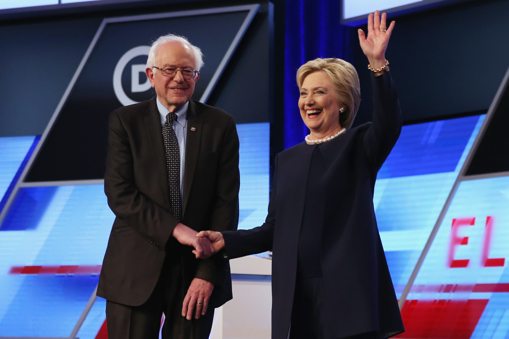 File: Bernie Sanders and Hillary Clinton appear at a presidential primary debate in Miami on March 9, 2016.