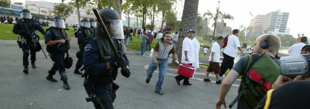 In this May 1, 2007 file photo, Los Angeles Police Metro Division officers advance on a crowd during an immigration rally in MacArthur Park.