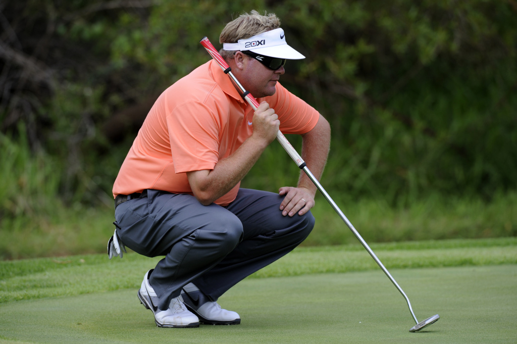 Peter Hanson of Sweden lines up a shot with his belly putter on day 2 of the 4 day 2012 Nedbank Golf Challenge in Sun City on November 30, 2012.