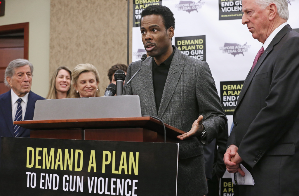 Actor Chris Rock (2nd R) speaks during a press conference hosted by the Mayors Against Illegal Guns and the Law Center to Prevent Gun Violence.