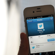 In this photo illustration, the Twitter logo and hashtag '#Ring!' is displayed on a mobile device as the company announced its initial public offering and debut on the New York Stock Exchange.
