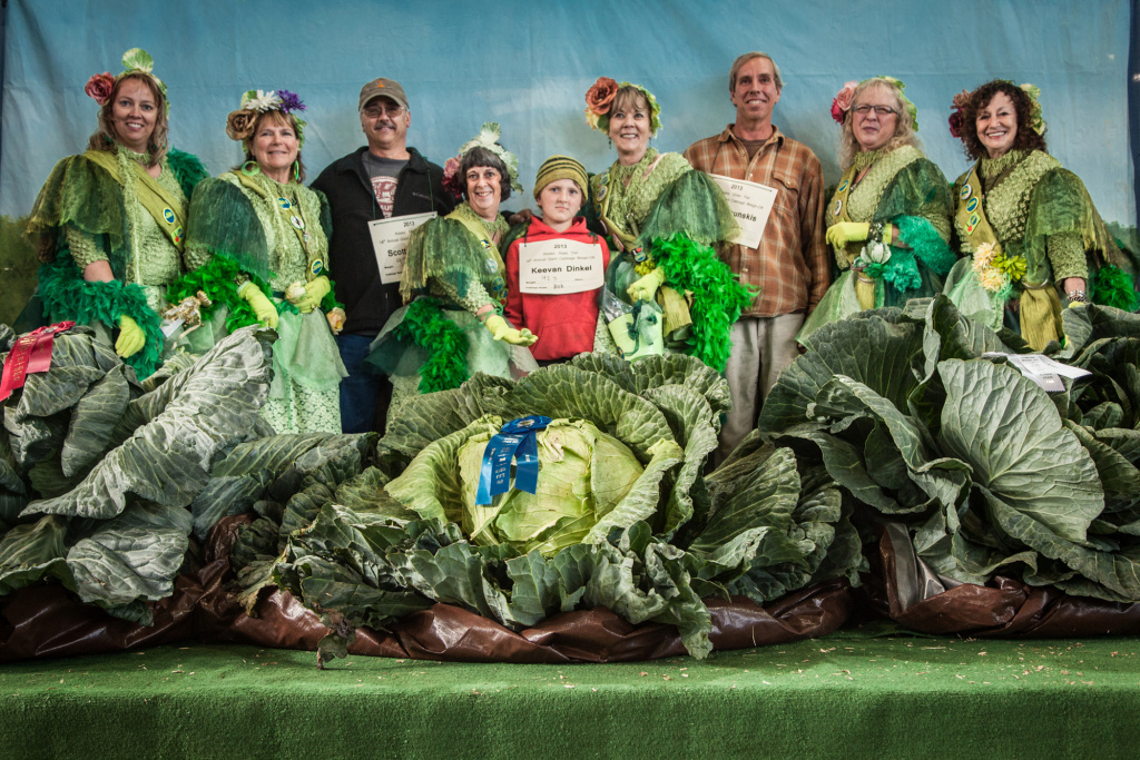 Giant Cabbage Weigh-Off 2013 winners (with placards, left to right): Scott Rob (92.10 pounds), Keevan Dinkel (92.30 pounds) and Brian Shunskis (77.40 pounds). The growers are joined by the cabbage fairies, a group of women who for 15 years have volunteered at the cabbage competition.