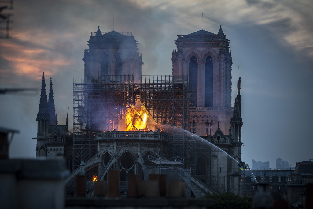 Smoke and flames rise from Notre-Dame Cathedral on April 15, 2019 in Paris, France.