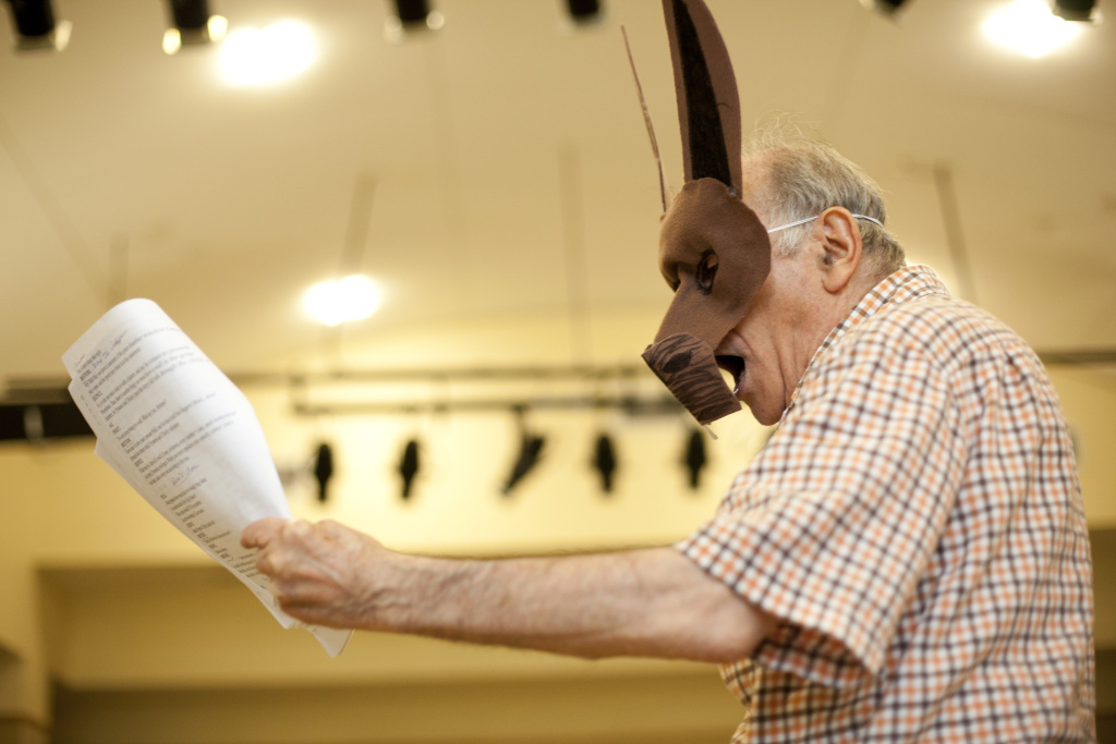 Harold Cherry rehearses as the Shakespeare character, Bottom.