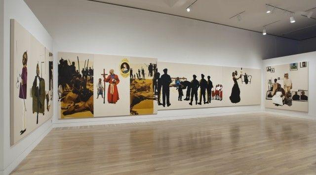 Installation view of Meleko Mokgosi's Pax Kaffraria: Sikhuselo Sembumbulu, 2012. Oil on canvas. 96 x 584 in.