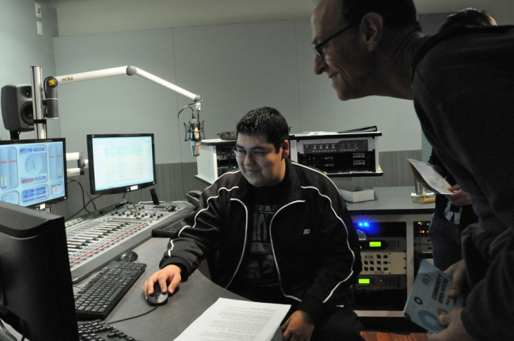 Alan Deane (right) at the KPCC open house with engineer Alex Gonzales (left).