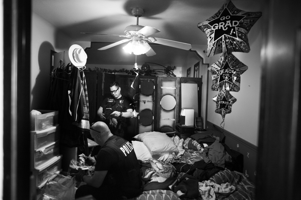 Riverside police officers look through the room of a probationer who had recently gone missing and has gang ties in Los Angeles. Riverside County utilizes this sort of supervision of former offenders about 80 percent of the time in lieu of serving a full jail sentence.