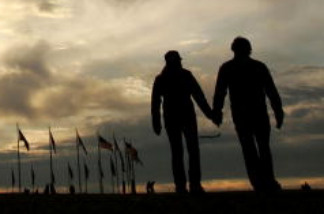 A silhouette of a couple holding hands