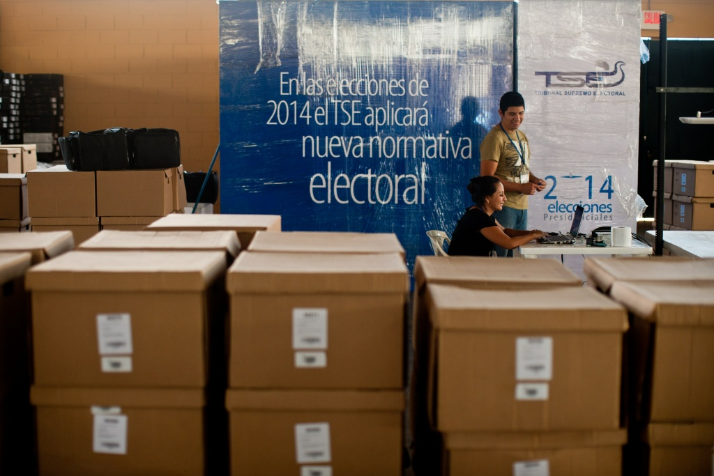 Election officers prepare data transmission system packages in San Salvador, El Salvador on January 30, 2014 in the preparation for the presidential elections to be held on February 2.